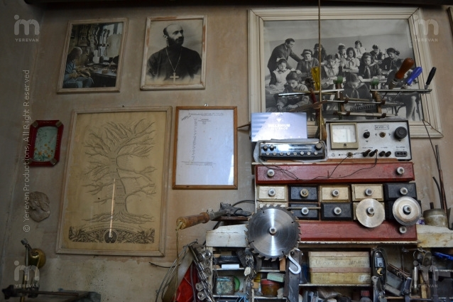 Jora's workshop, instruments and the photo of his class on top right
